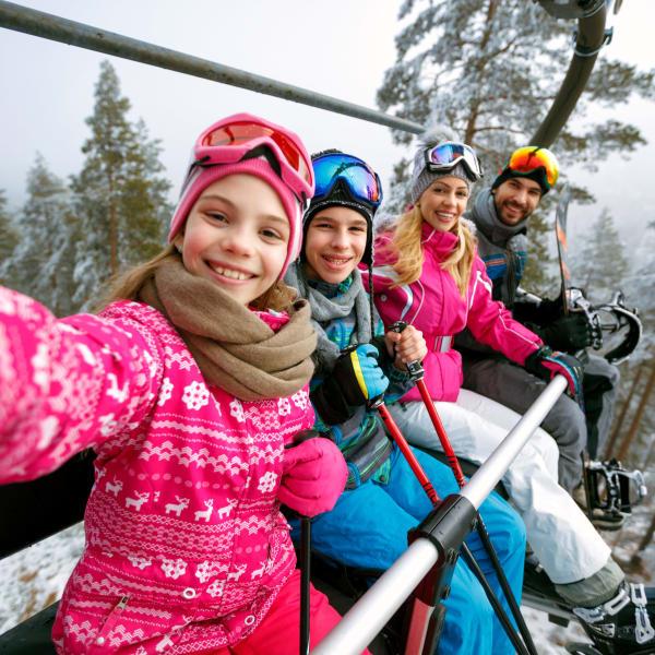 Family on a ski lift near Ocio Plaza Del Rio in Peoria, Arizona