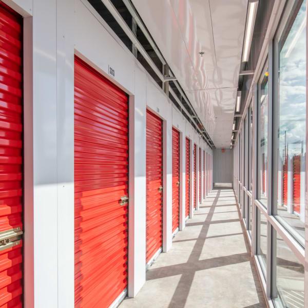 Indoor storage units with bright doors at StorQuest Self Storage in Englewood, Colorado