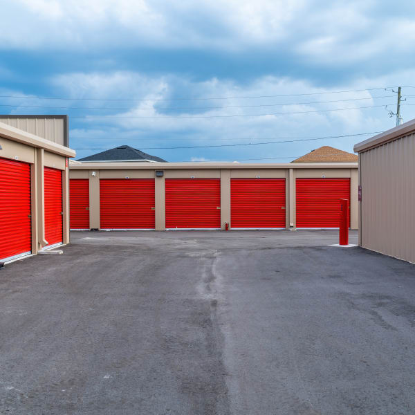 Outdoor storage units with bright doors at StorQuest Express Self Service Storage in Sacramento, California