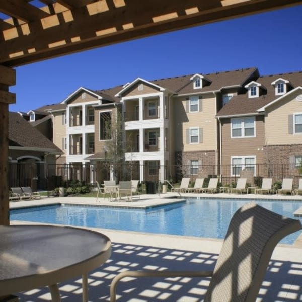Resort-style swimming pool at Magnolia Park Apartment Homes in Chalmette, Louisiana
