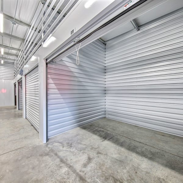 Indoor climate-controlled units with the doors open at StorQuest Express - Self Service Storage in Tracy, California
