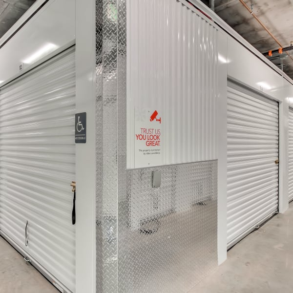 Indoor storage units with white doors at StorQuest Self Storage in Hawthorne, California