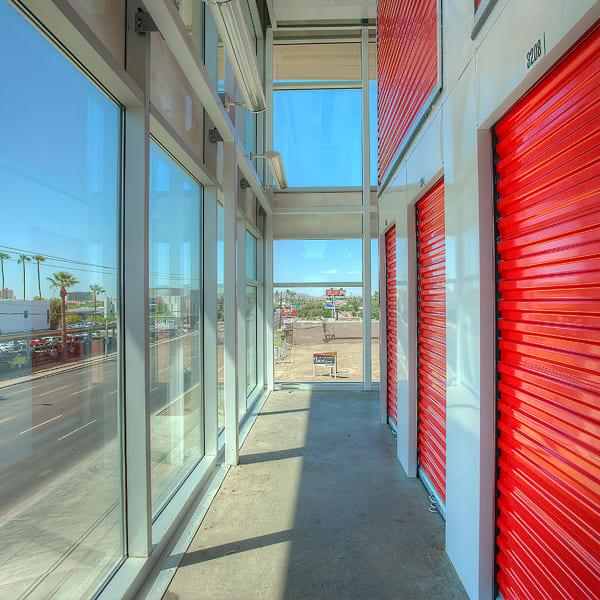 Indoor storage units with bright doors at StorQuest Self Storage in Miami, Florida