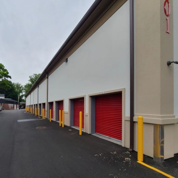 Outdoor storage units with bright doors at StorQuest Self Storage in Thornwood, New York