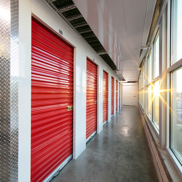 Red doors on indoor units at StorQuest Self Storage in Anaheim, California