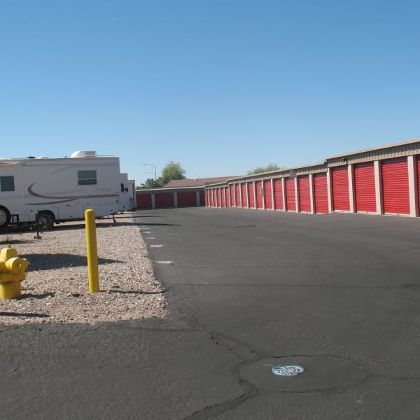 Outdoor storage units with bright doors at StorQuest Self Storage in Apache Junction, Arizona