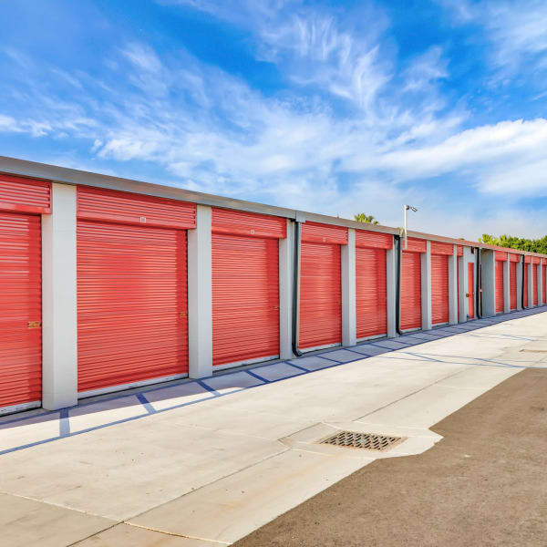 Red doors on outdoor units at StorQuest Self Storage in Gainesville, Florida