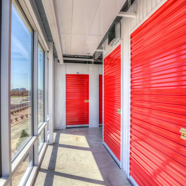 Red doors on indoor units at StorQuest Self Storage in Aurora, Colorado