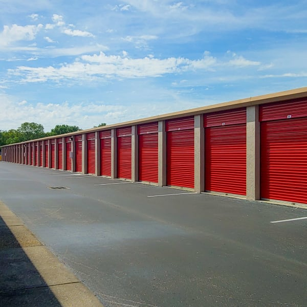 Outdoor storage units with red doors at StorQuest Self Storage in Bradenton, Florida