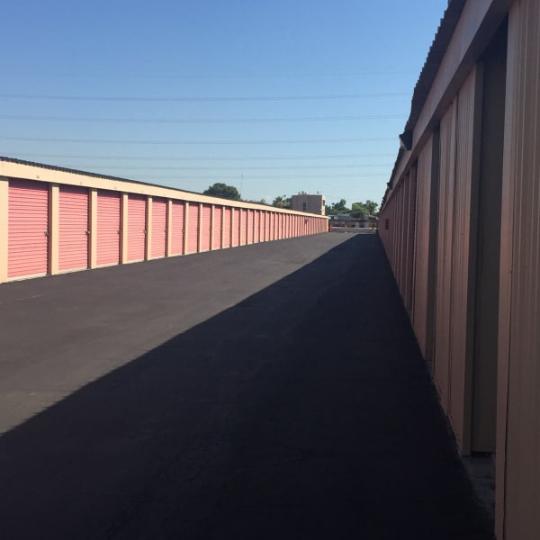 Outdoor storage units with bright doors at StorQuest Self Storage in Glendale, Arizona