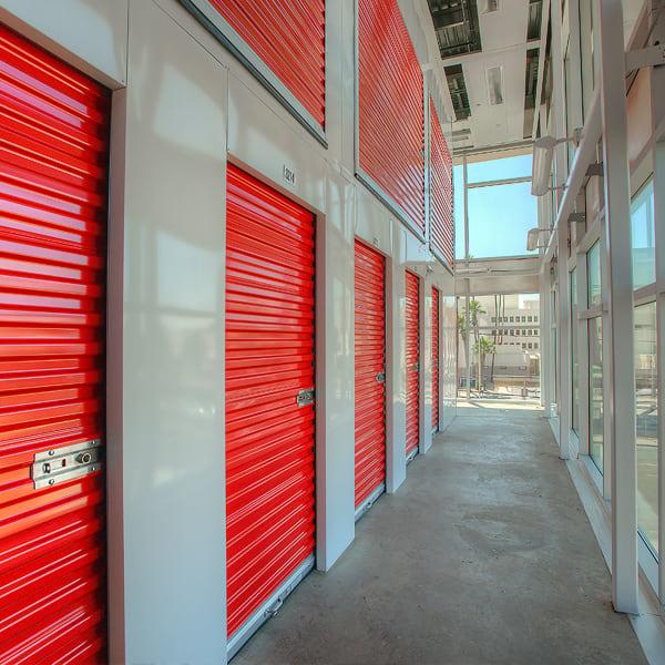 Indoor storage units with bright doors at StorQuest Express Self Service Storage in Castle Rock, Colorado