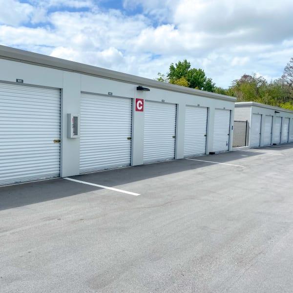 Indoor storage units with bright doors at StorQuest Self Storage in Tarpon Springs, Florida