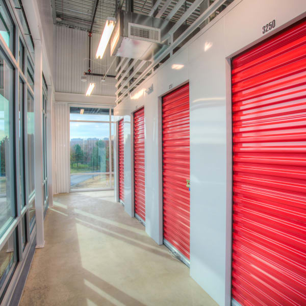 Climate-controlled interior units with red doors at StorQuest Self Storage in Greenwood Village, Colorado