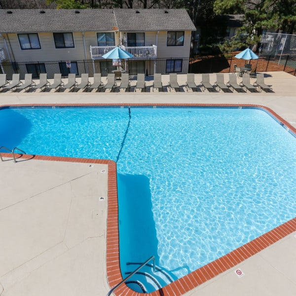 Massive pool surrounded by lounge chairs at The Flats at Arrowood in Charlotte, North Carolina