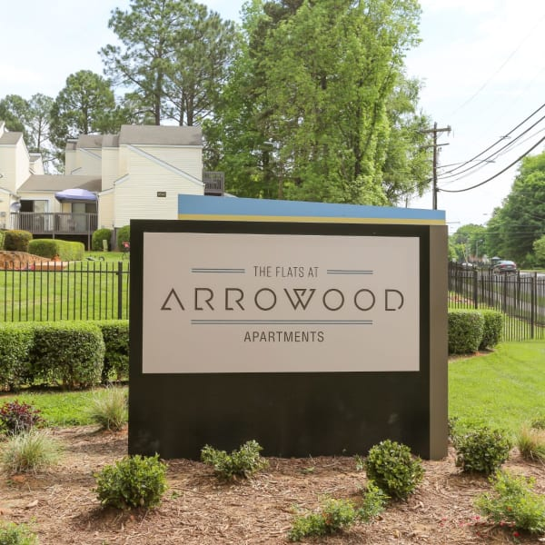 Welcoming sign in the front area at The Flats at Arrowood in Charlotte, North Carolina