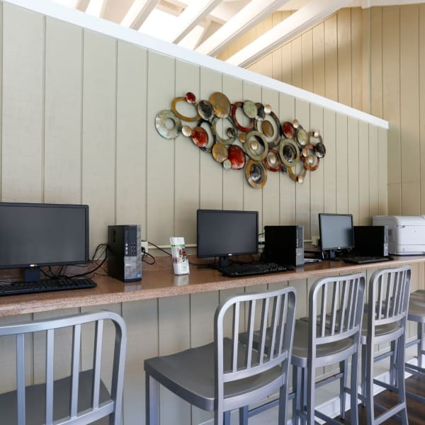 Work area for residents to use with many open computers at The Flats at Arrowood in Charlotte, North Carolina