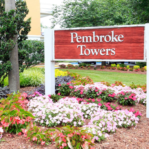 Exterior welcoming sign in front of the building at Pembroke Towers in Norfolk, Virginia