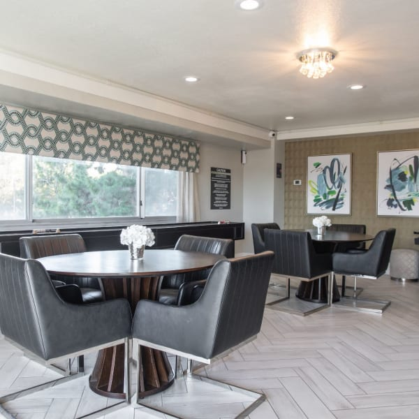 Resident lounge area with tables and chairs to eat and hang out in at Pembroke Towers in Norfolk, Virginia