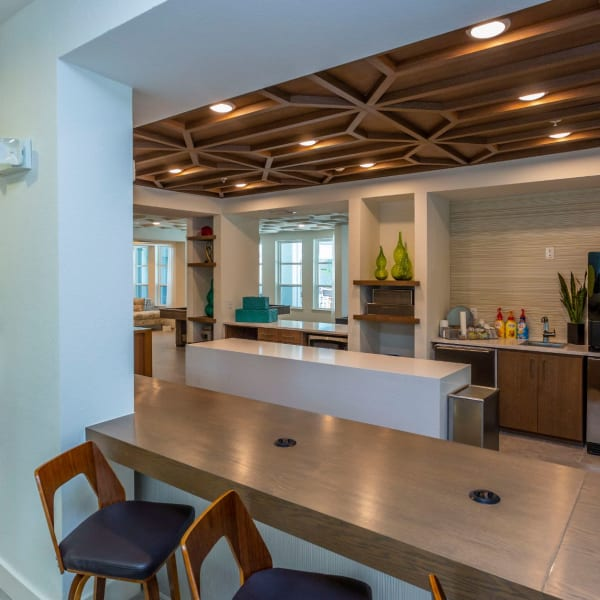 Bar seating in the resident clubhouse lounge at 50 Paramount in Sarasota, Florida