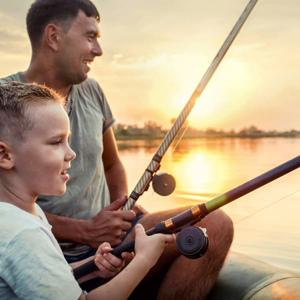 Residents out fishing at a lake near Olympus at Waterside Estates in Richmond, Texas