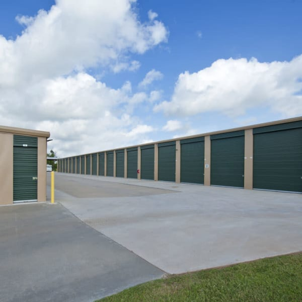 Outdoor storage units with green doors at StorQuest Self Storage in Stockton, California