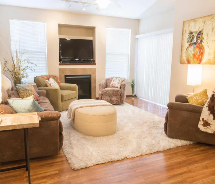 Comfortable fireside seating in the living room at Tradition Pointe in Ankeny, Iowa
