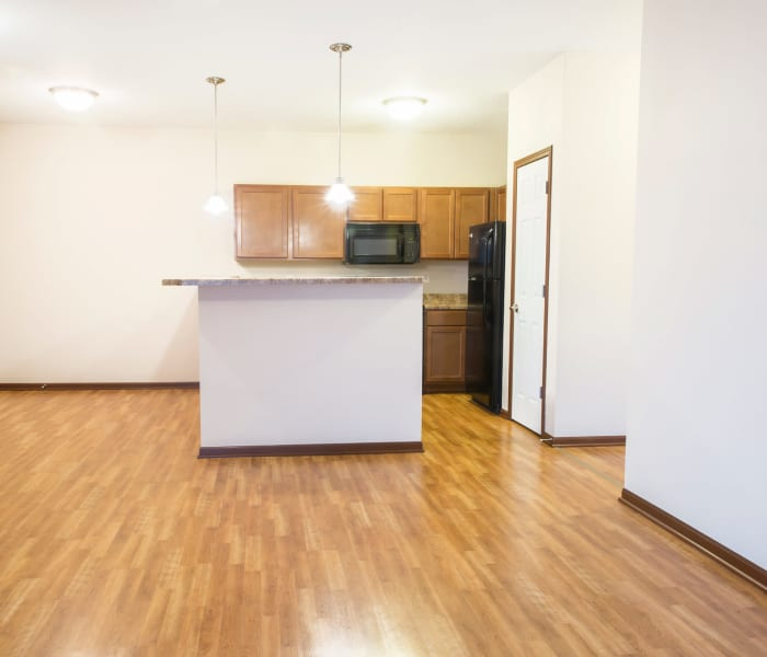 Wood flooring in the kitchen and dining room at The Reserve at Glenstone in Grimes, Iowa