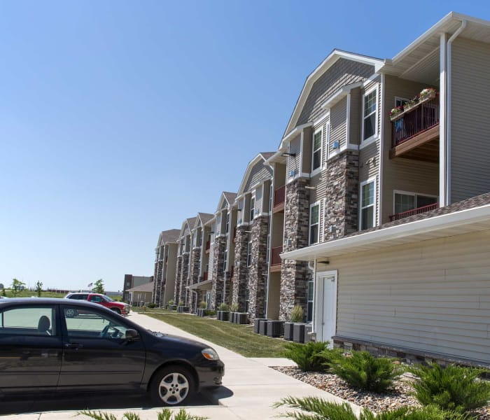 Apartment exterior and parking lot at Providence Pointe in Johnston, Iowa
