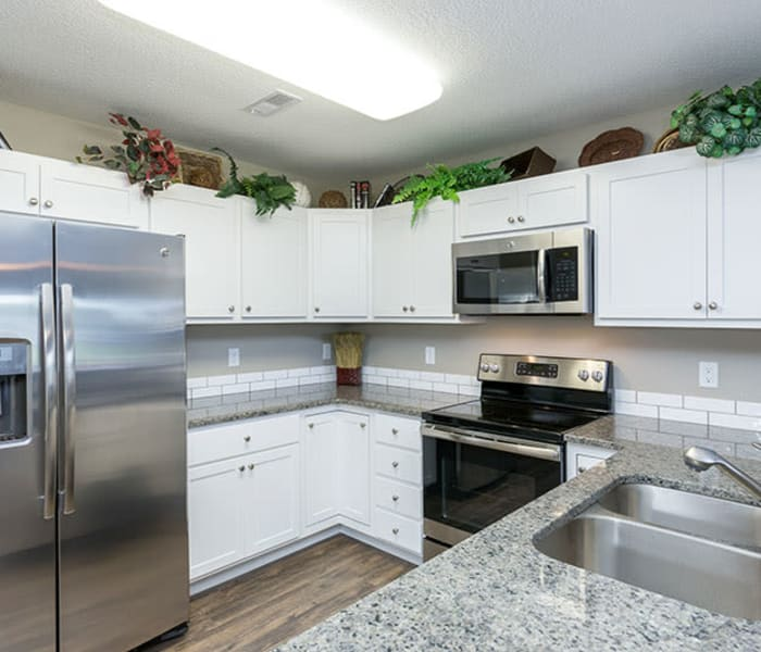 Stainless steel appliances in an apartment kitchen at The Landing of Clinton in Clinton, Iowa