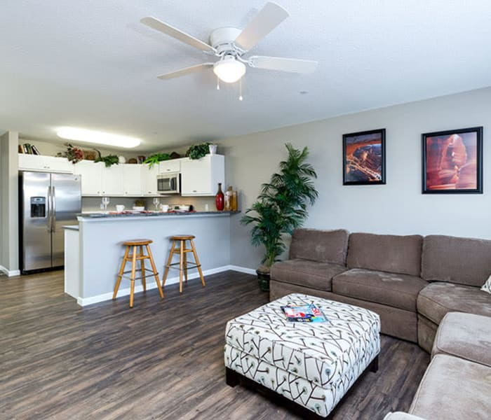 Wood flooring in an apartment living room and kitchen at The Landing of Clinton in Clinton, Iowa