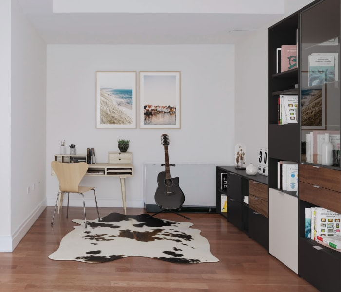 Office nook with wood style-flooring at 21 West Street in New York, New York