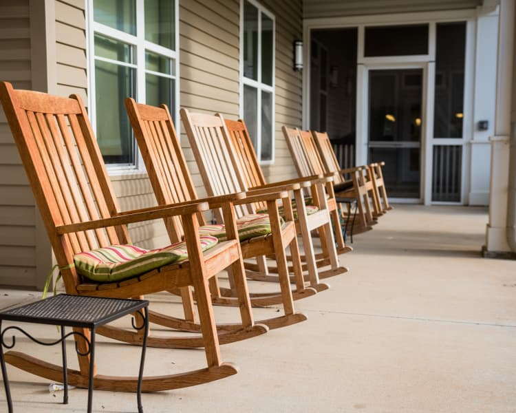 Outdoor seating at Avenir Memory Care at Fayetteville in Fayetteville, AR