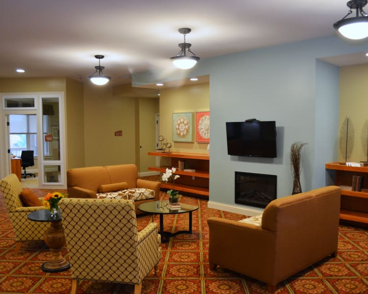 Fire place at Avenir Memory Care at Little Rock in Little Rock, AR