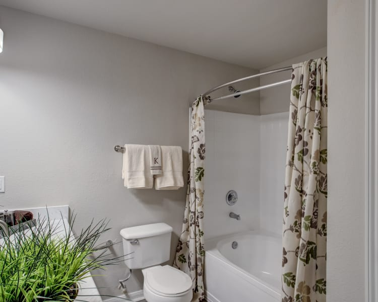 Large bathroom with updated fixtures in renovated apartment home at Kenwood Club at the Park in Katy, Texas