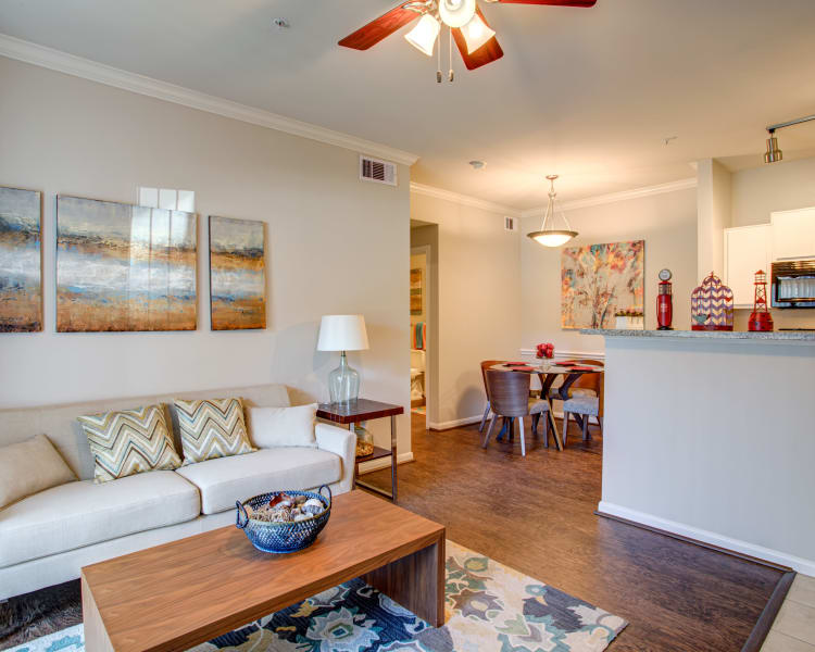 An apartment living room, dining room and kitchen at Regatta Bay in Seabrook, Texas