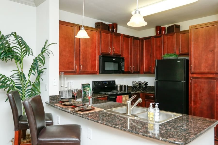 View of the modern and well-equipped kitchen in model home at Villas at Bunker Hill