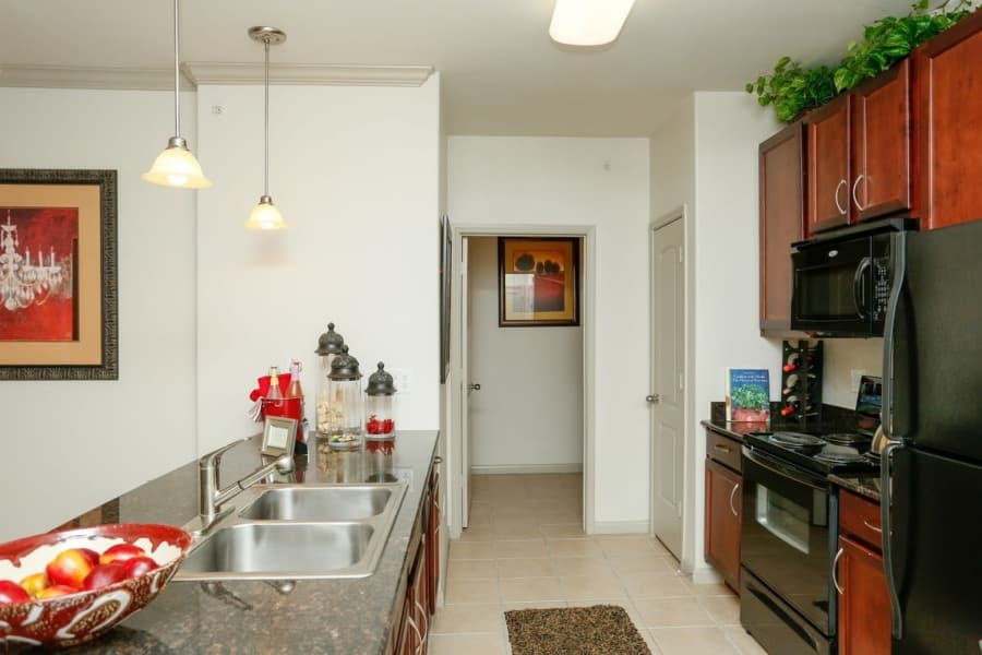 Model apartment home kitchen and breakfast bar view at Villas at Bunker Hill
