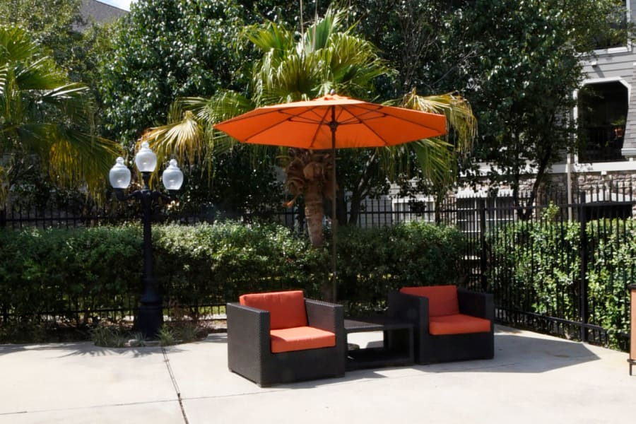 Comfortable shaded seating near the pool at The Club at Stablechase