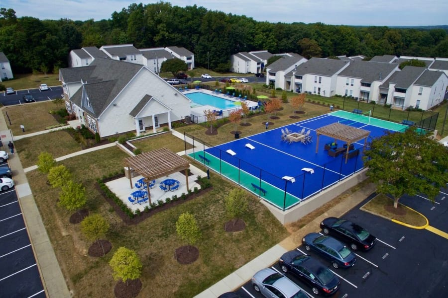 Aerial view of The Residences of Westover Hills in Richmond, VA showcasing the volleyball court, fire pit, and outside BBQ area