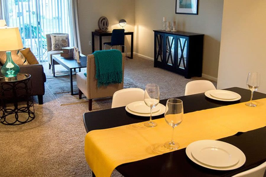 Dining area in model home with living area in the background at The Residences of Westover Hills in Richmond, VA