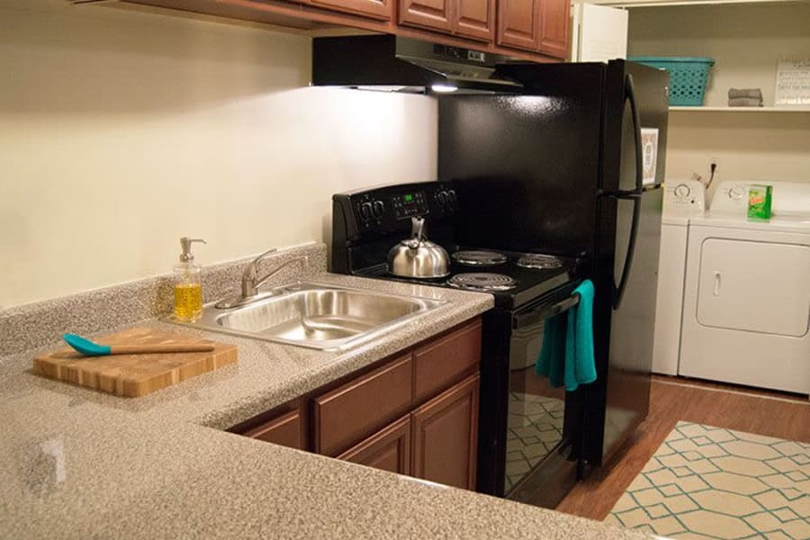 Modern kitchen with black appliances at The Residences of Westover Hills in Richmond, VA