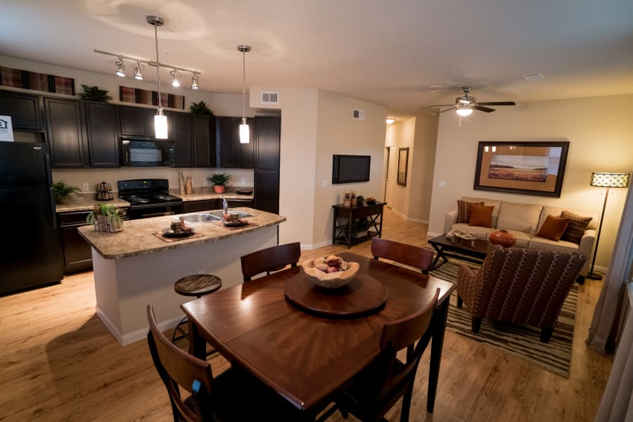 Kitchen, dining and living area at Queenston Manor Apartments in Houston, Texas