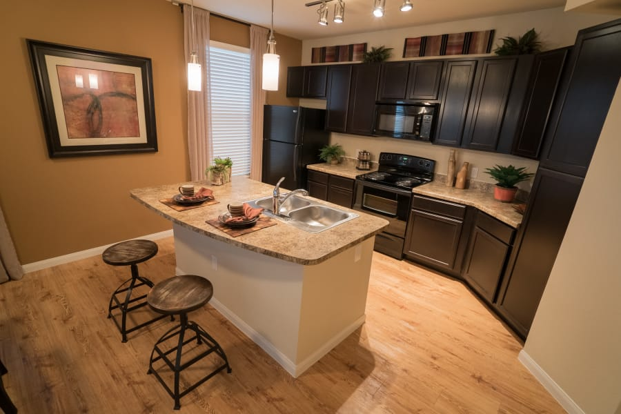 Well-appointed kitchen with black appliances at Queenston Manor Apartments