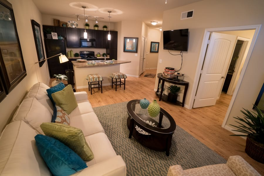 Living room at Queenston Manor Apartments in Houston, Texas