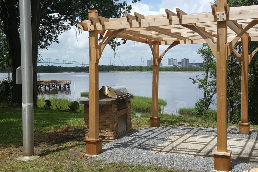 Shaded waterfront outdoor BBQ area at Pier 5350 in Jacksonville, Florida