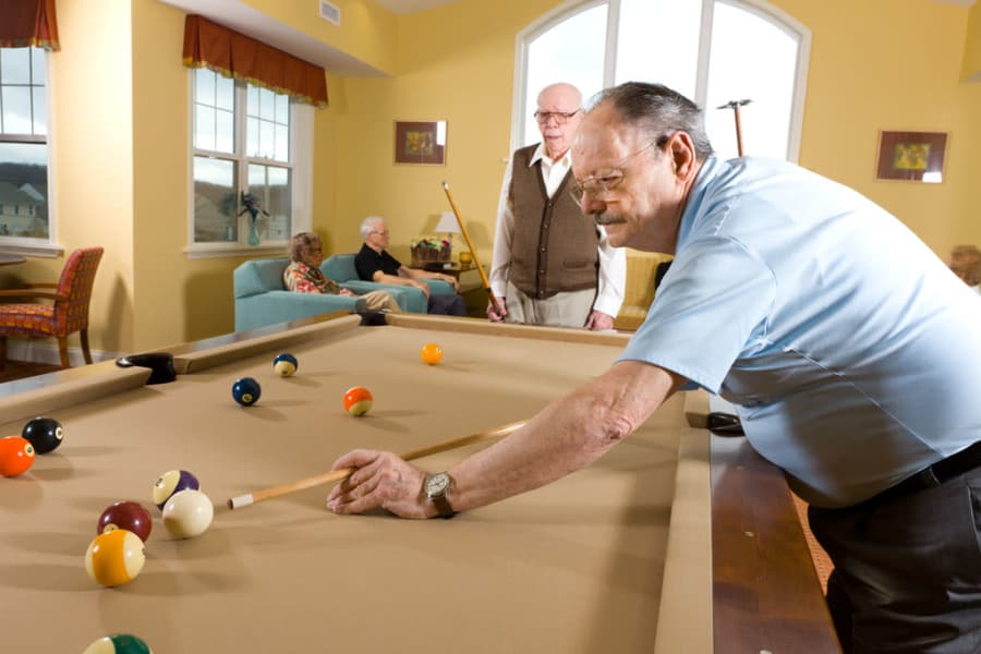 Residents playing pool at Traditions of Hershey in Palmyra, Pennsylvania
