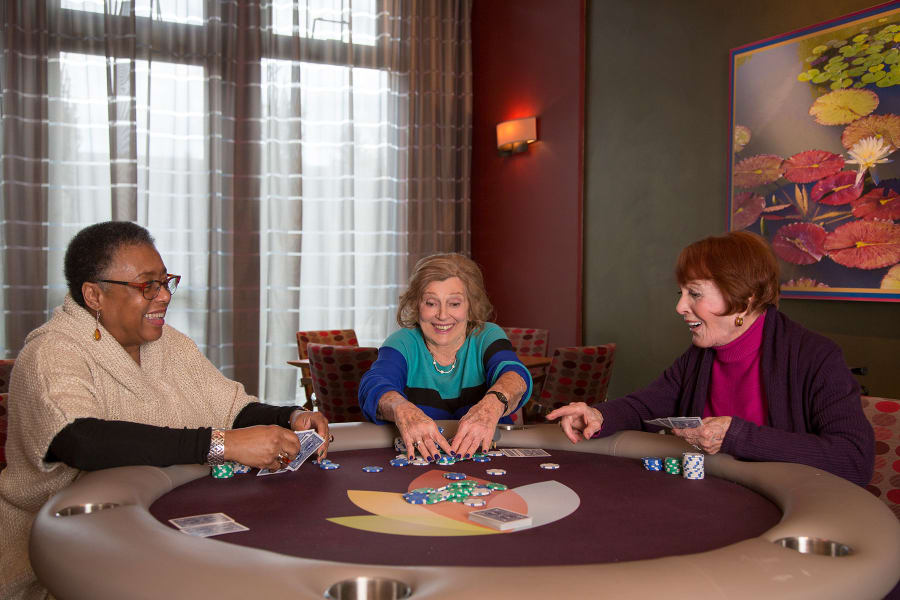 Residents playing cards in the game room at Bella Vista Senior Living in Mesa, Arizona
