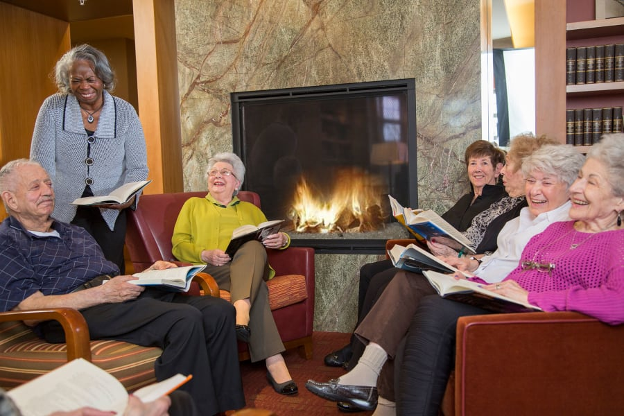 Residents in the book club discussing their latest read at All Seasons Ann Arbor in Ann Arbor, Michigan