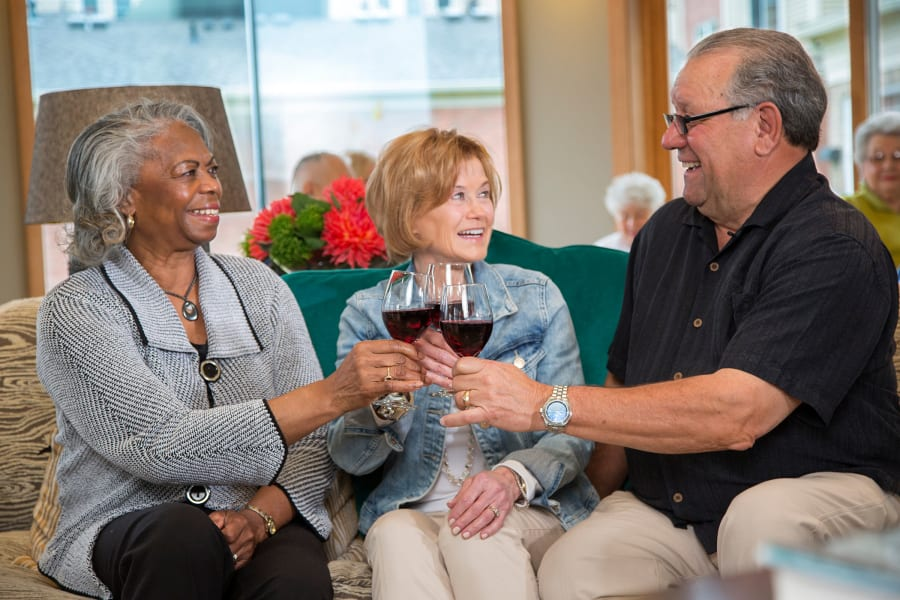Residents raising a toast to the good life at Casa Del Rio Senior Living in Peoria, Arizona