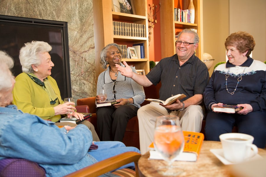 Residents in the book club discussing their latest read at All Seasons Oro Valley in Oro Valley, Arizona